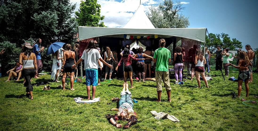 A group of people at a psychedelic festival