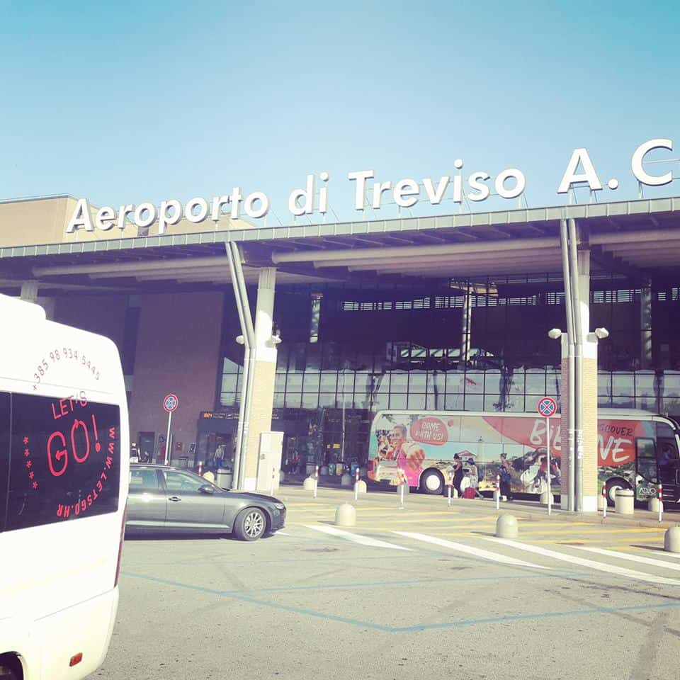Let's go transfer service minivan standing in front of the Treviso airport